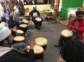 Students in the Hip Hop in Africa class taking a drum lesson.